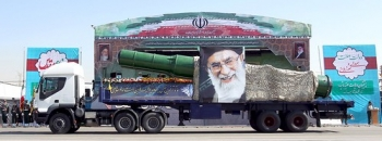 "A military truck carrying a missile and a picture of Iran's Supreme Leader Ayatollah Ali Khamenei is seen during a parade marking the anniversary of the Iran-Iraq war (1980-88), in Tehran September 22, 2015. • <a style=""font-size:0.8em;"" href=""http://www.flickr.com/photos/139546847@N02/25195417615/"" target=""_blank"">View on Flickr</a>"