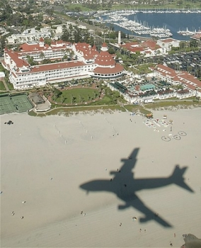 "The shadow of Air Force One passes over the beach in front of the historic Hotel del Coronado in Coronado, Calif., Monday, Aug. 29, 2005. • <a style=""font-size:0.8em;"" href=""http://www.flickr.com/photos/139546847@N02/30021429550/"" target=""_blank"">View on Flickr</a>"